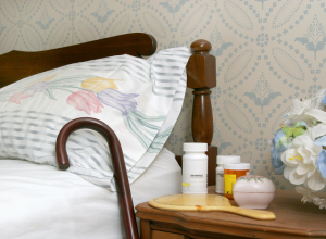 Client room with prescriptions waiting on nightstand