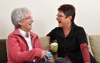 Home Care Denton: Laughing with Friend
