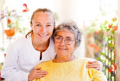Client and caregiver on outdoor patio