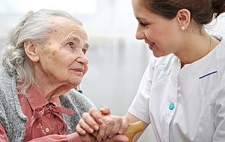 Woman with Caregiver: Home Care Focus: Reducing Hospital Readmissions